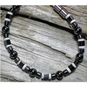 Black & White Puka Shell Magnetic Bracelet Everything