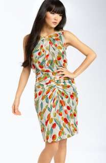 Expertly ruched seaming creates a figure flattering effect in a