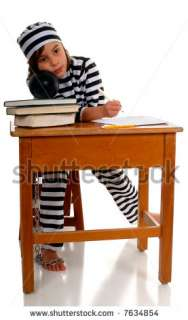 stock photo  A sad elementary girl sitting at a school desk in a