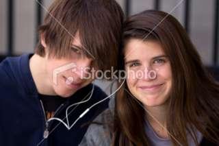 Teen boy and girl sharing music Royalty Free Stock Photo