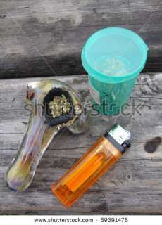 stock photo : Jar of Medical Marijuana, Pipe and lighter sitting on a